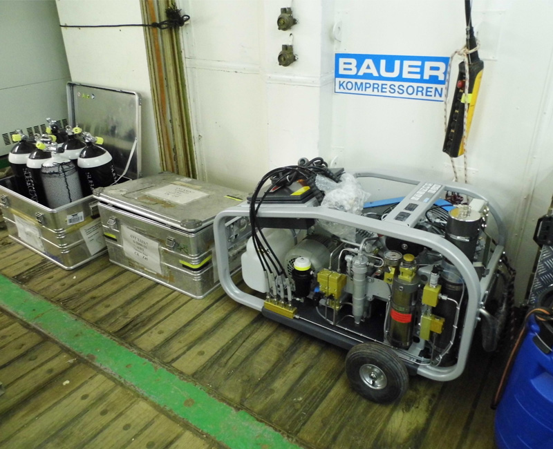 The BAUER compressor unit in the loading area